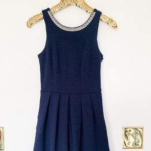 Navy Flair Bow Back Dress with Embellishments